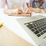 Laptop keypad and notepad with pen at workplace - Want to get your book manuscript noticed? Here are 3 things that stand out - good or downright terrible - when new manuscripts hit my desk - The Omnibus Publishing